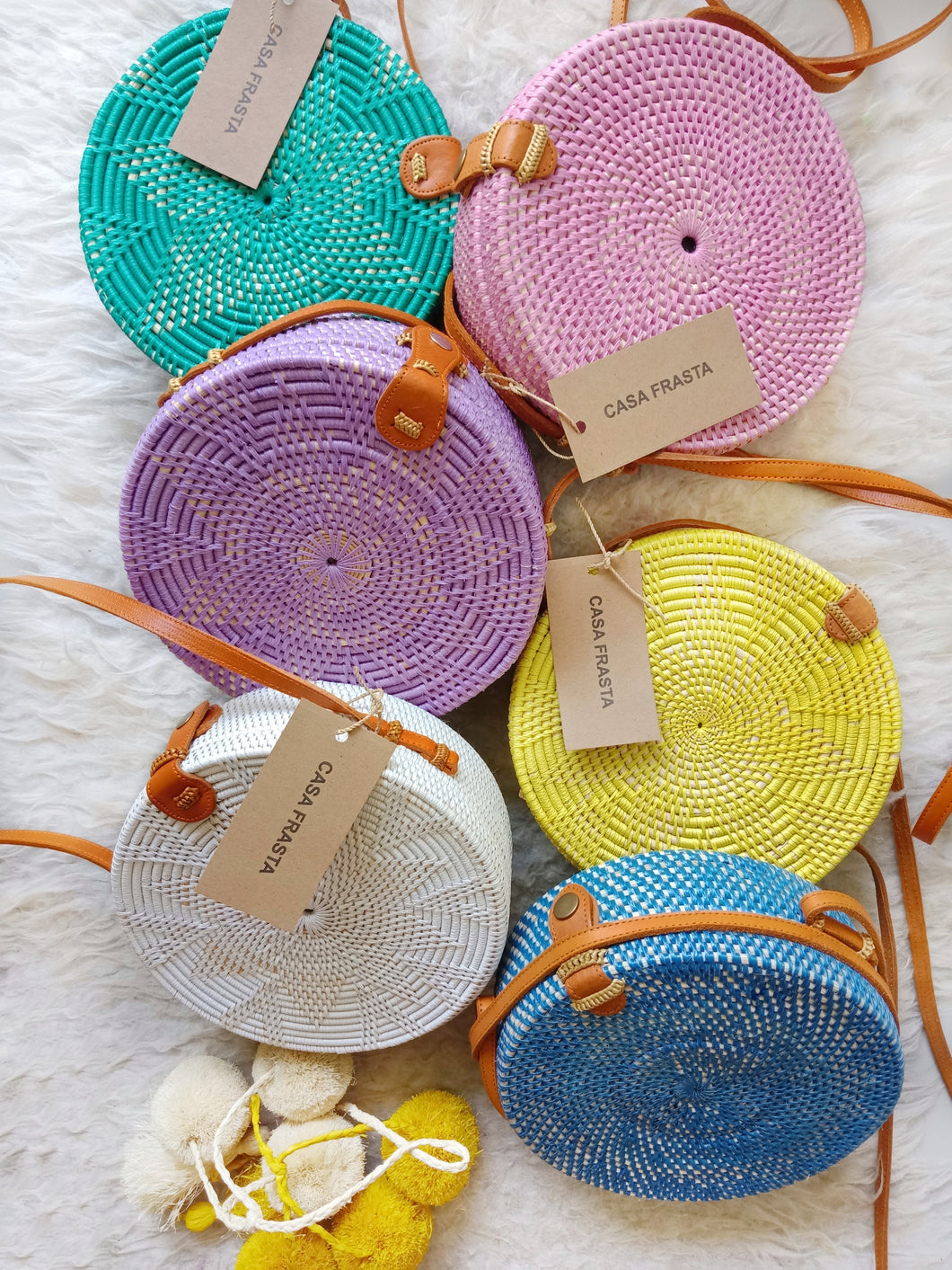 Gorgeous colored rattan bag perfect for all weather, this Bali bag is handwoven, perfect for Hong Kong Diaries and rattan bag outfit street style.