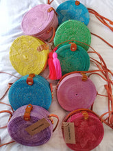 Colorful round rattan bag for summer or beach days to store your beach accessories