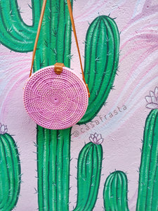pinky lover would be happy with this pink round rattan bag