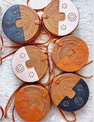 Round rattan bag with leather