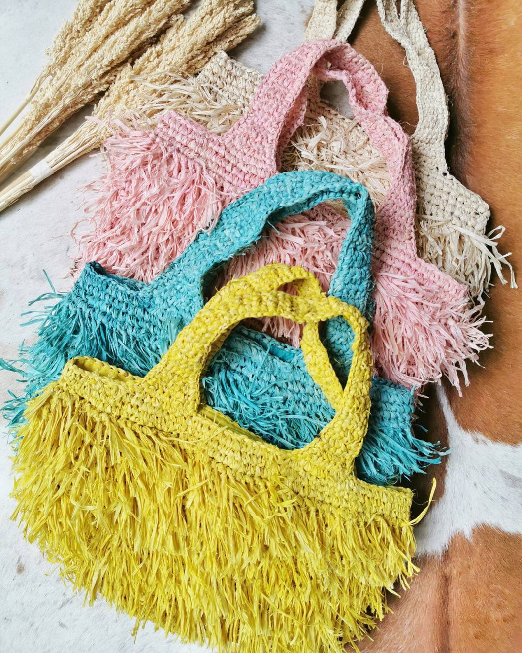All of our Raffia Bali bags are handcrafted by local Balinese artisans using natural raffia, giving you a lasting one-of-a-kind product