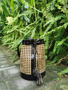 Rattan backpack made from organic and natural materials, perfect rattan bags for the summer and for tropical vacations, adjustable straps and tassels