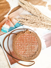 Absolutely perfect rattan bag, its exactly what you are looking for amazing clasp with adjustable strap