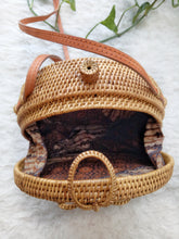 This rattan bag is very cute, high quality, and the size is perfect for everyday things. I love it!