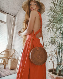 Handcrafted by local Balinese artisans this classic round beach rattan bag is the talk of the town, easy to carry and each purse has its own story