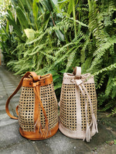 The rattan purse backpack is beautiful and as described, you can put a smaller clutch inside to keep loose items or it really is pretty secure without.