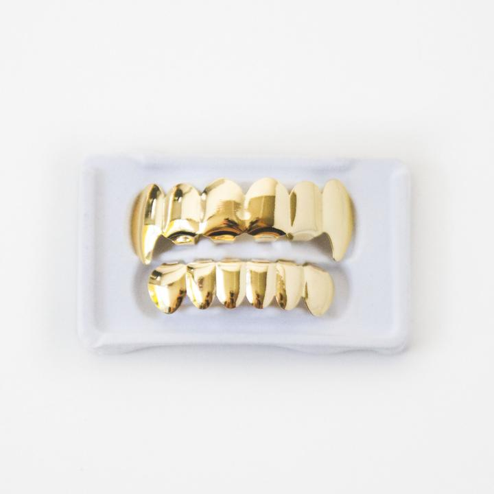 Fake 14k Gold Plated Vampire Fang Grillz