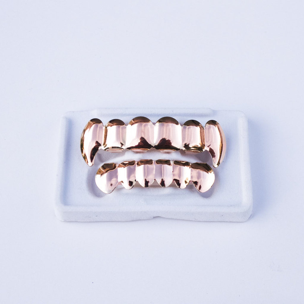 Fake 14k Rose Gold Vampire Fang Grillz