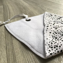 Spotty monochrome fleece-lined cotton dribble bib with soother holder