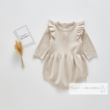 Premium nude cable knitted frill shoulder romper (up to 2 years)