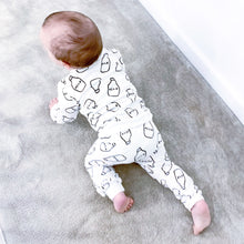 Unisex milk print lounge suit with a head band for the girls