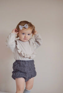 Grey ruffle long sleeve jersey romper