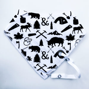 Woodland animals monochrome fleece-lined cotton dribble bib with soother holder