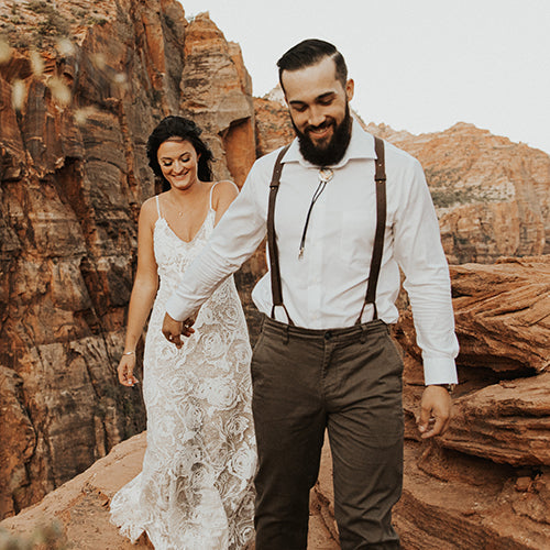 bride-and-groomsmen-in-mountains-wearing-wiseguy-suspenders