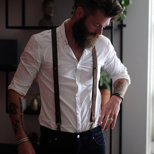 Man with button shirt, jeans and leather Wiseguy Suspenders