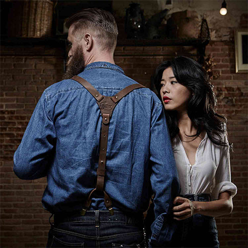 Woman and a man wearing denim and leather Wiseguy Suspenders