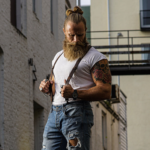 Man wearing a t-shirt, jeans and leather Wiseguy Suspenders