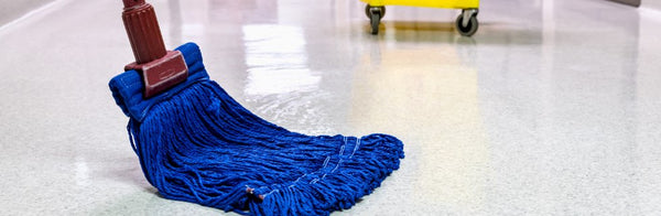 Floor being cleaned with an industrial mop head