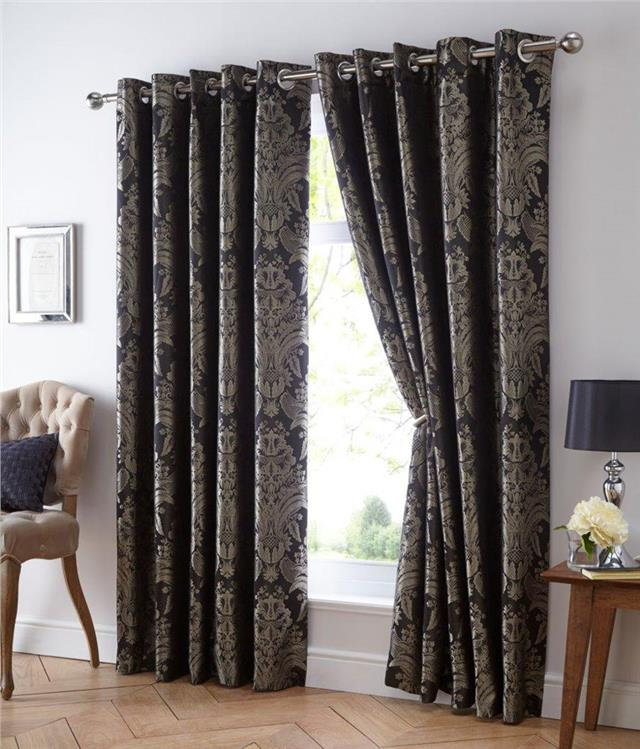 Pair of lined curtains eyelet ring top style on embroidered jacquard fabric