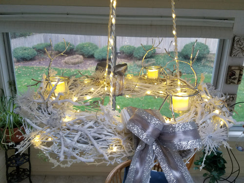 White winter reindeer chandelier with twinkle lights