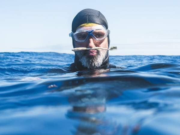 swimmer finds plastic toothbrush in the ocean