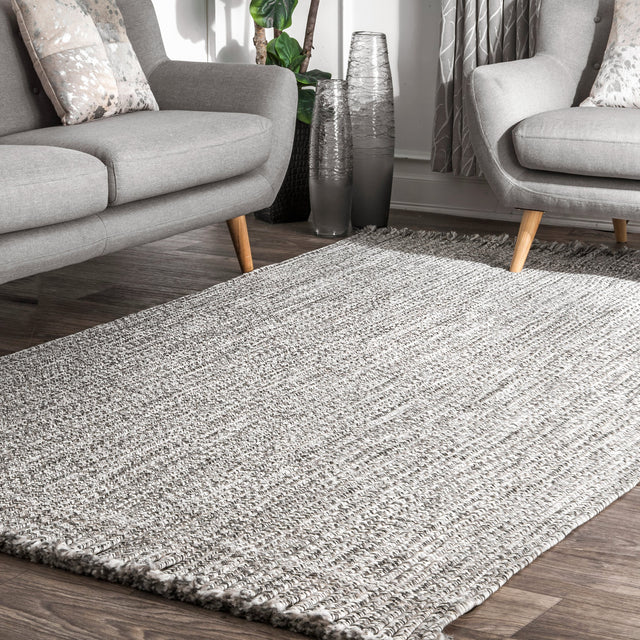 BRAIDED COURT TASSEL PEPPER RUG