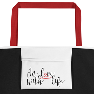 I am lucky by in love with life, white bag, black/red writing, red handle, inside pocket