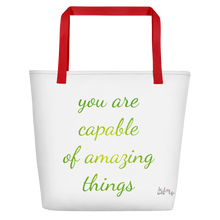 You are capable of amazing things by in love with life, white bag, red handle, green/yellow writing