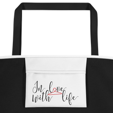 I am lucky by in love with life, white bag, black/red writing, black handle, inside pocket