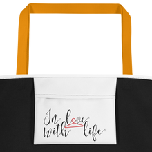 I am lucky by in love with life, white bag, black/red writing, yellow handle, inside pocket