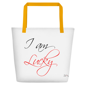 I am lucky by in love with life, white bag, black/red writing, yellow handle