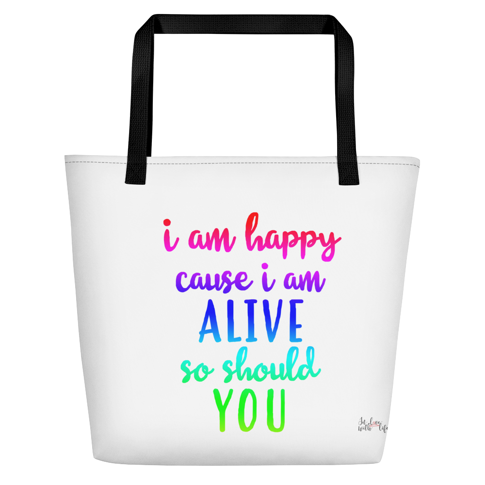 I'm happy cause I'm alive. So should YOU by in love with life, white bag, multi-colored writing, black handle