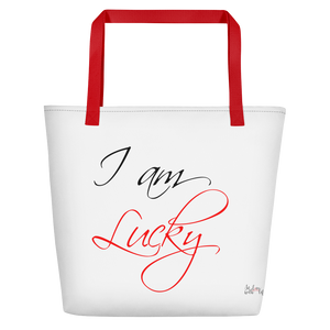 I am lucky by in love with life, white bag, black/red writing, red handle