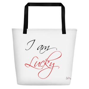 I am lucky by in love with life, white bag, black/red writing, black handle