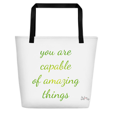 You are capable of amazing things by in love with life, white bag, black handle, green/yellow writing