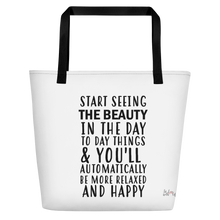 Start seeing the beauty in the day to day things & you'll automatically be more relaxed and happy by in love with life, white bag, black writing, black handle