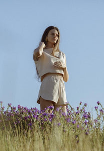 Model in a field wearing the Beth shorts