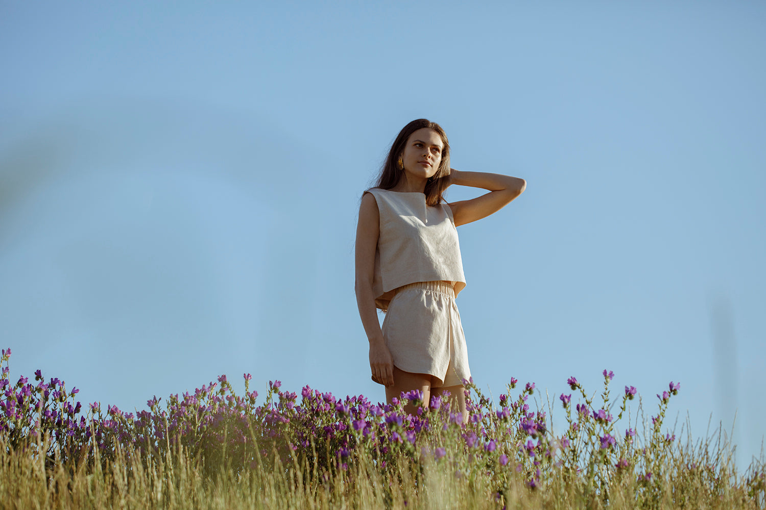 Model wearing Beth top standing in the field