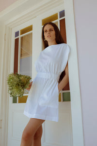 model in a white marina dress
