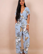 Wrap Front Wide Leg Jumpsuit In Blue Tropical Print