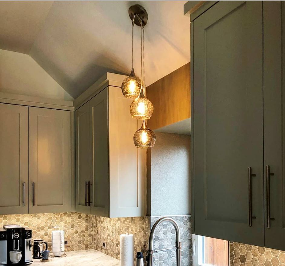 How do I hang a pendant light from a vaulted or sloped ceiling?