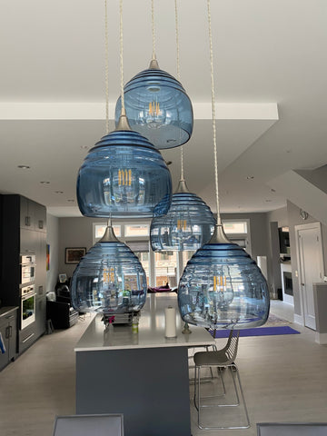 Bicycle Glass 5-Pendant Cascade Chandelier featuring Lucent 302s in Steel Blue in a Kitchen