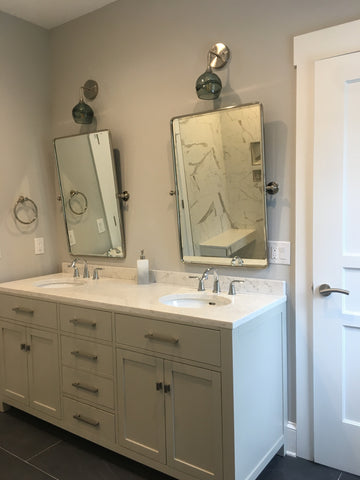Bicycle Glass Swell 763 Wall Sconces in Gray with Brushed Nickel Hardware, bathroom lights over mirror and two sink vanity, lights off