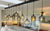 multi-pendant light fixture with an eclectic mix of glass shapes