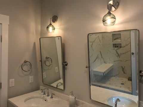 Bicycle Glass Swell 763 Wall Sconces in Gray with Brushed Nickel Hardware, bathroom lights over mirror and two sink vanity, close up shot of lights on