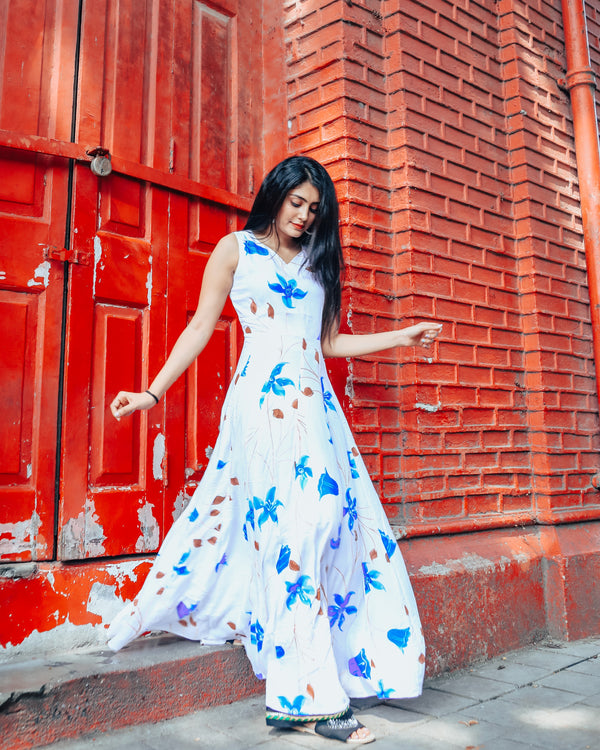 White base with blue floral handprinted dress