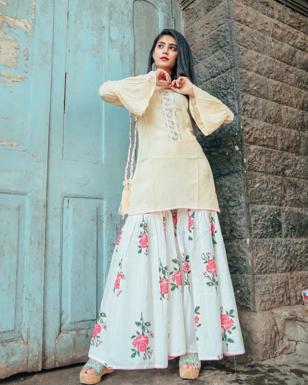 Cream hand embroidered kurta set with beautiful potli