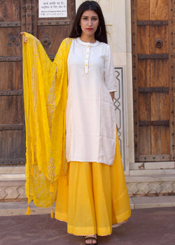 A Beautiful White Yellow Kurta Set Paired With Beautiful Karanchi Work Dupatta