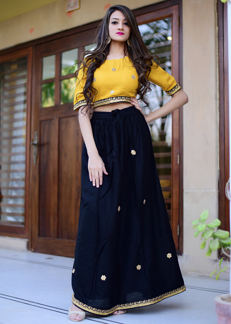 Yellow top with black skirt