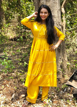 Yellow suit set with sikhiya gota work